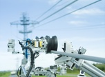 The LineScout is designed to clear obstacles on the transmission line.